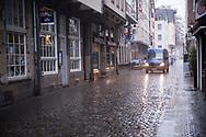 Coronavirus / Covid 19 outbreak, January 28th. 2021. The deserted street Buttermarkt in the old town, rainy weather, Cologne, Germany.<br /> <br /> Coronavirus / Covid 19 Krise, 28. Januar 2021. Der menschenleere Buttermarkt in der Altstadt, Regenwetter,  Koeln, Deutschland.