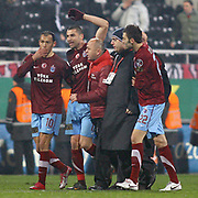 Trabzonspor's Burak YILMAZ (2ndL) celebrate his goal during their Turkish Superleague Derby match Besiktas between Trabzonspor at the Inonu Stadium at Dolmabahce in Istanbul Turkey on Sunday, 06 March 2011. Photo by TURKPIX
