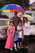 A family at a rainy  Durham Zombie Walk in Durham, North Carolina.