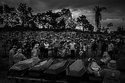 Coffins arrive on a tractor to be placed in a mass grave at Nossa Senhora Aparecida Cemetery, located in the West Zone of Manaus, Amazonas, Brazil, on April 23, 2020. A new area of the cemetery was opened after the deaths caused by COVID-19 caused a collapse in the city's funeral system. The number of burials in Manaus per day increased from about 30 to more than 100, due to the coronavirus pandemic. The collapse forced the burials to be carried out collectively. Only a maximum of three relatives of each dead person could attend the funeral. The coffins were put together in a trench dug with the support of a mechanical shovel.