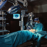 Dr Rand in operating room performing eye surgery.