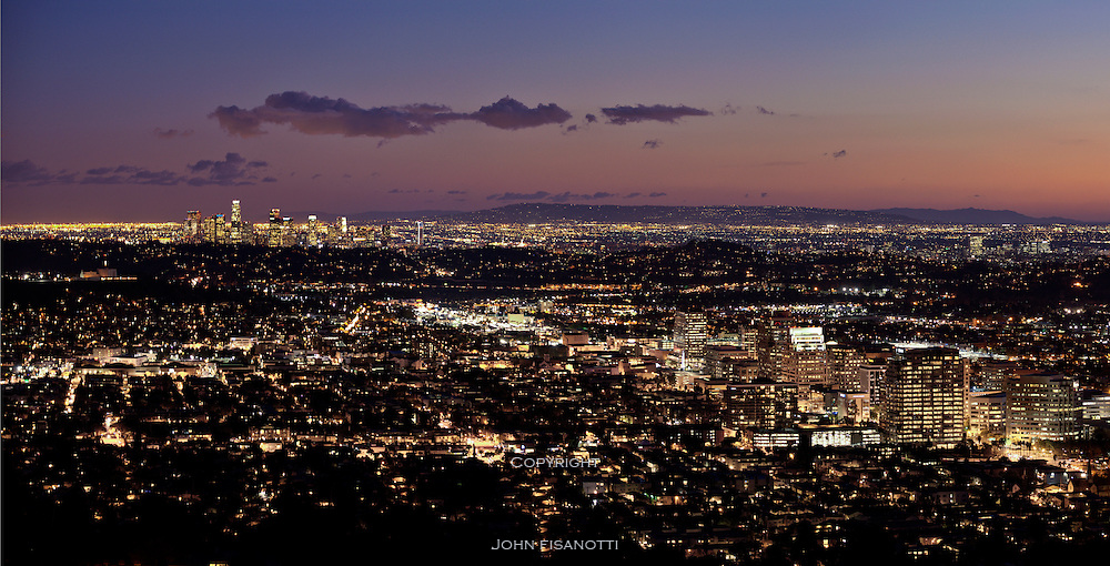 Downtown Glendale is in the foreground, Los Angeles is in the middle ground,the hills of the Palos Verdes Peninsula can be seen on the horizon, and beyond that, the silhouette of Catalina Island is visible.