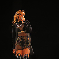"""ST PAUL, MN - MARCH 24:  Rihanna performs during her """"Diamonds"""" world tour at Xcel Energy Center on March 24, 2013 in St. Paul, Minnesota. (Photo by Adam Bettcher/Getty Images) *** Local Caption *** Rihanna"""