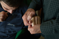 Wayne Cox stretches the hand of his son Chris,   a traumatic brain injury survivor, Destin, Fla., Nov. 18, 2011. Cox's parents, who take care of him, must stretch his hands, legs and other parts of his body to relieve the tension caused by the brain injury. Cox was left with debilitating back pain after an A.T.V. accident. He underwent physical therapy to no avail and accidentally overdosed on Oxycontin, leaving him clinically deceased for 15 to 30 minutes. He was revived but suffered severe lack of oxygen to his brain and was diagnosed as minimally conscious. Cox's family entered him into a clinical trial, testing medicines that evoked Òparadoxical excitation,Ó such as Ambien, and have witnessed a heightened sense of awareness in their son.