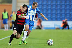 Peterborough United's Lee Tomlin battles with Colchester United's David Wright  - Photo mandatory by-line: Joe Dent/JMP - Tel: Mobile: 07966 386802 06/08/2013 - SPORT - FOOTBALL - Weston Homes Community Stadium - Colchester -  Colchester United V Peterborough United - Capital One Cup - First Round