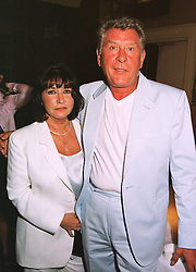 MR & MRS MICKY MOST he is the record producer, at a dinner in London on 20th July 1998.MJE 11