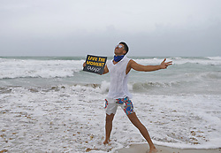 Javier Narvaez poses for as his daughter Juliana, not pictured, takes a photo at Miami Beach as the outer bands of Hurricane Irma reach South Florida early on Saturday, September 9, 2017. Photo by David Santiago/El Nuevo Herald/TNS/ABACAPRESS.COM
