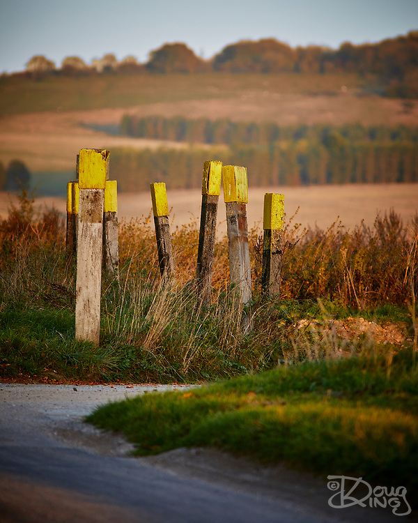 Weathered wooden posts mark Z Crossing on the British Army ranges on Salisbury Plain