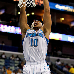 December 21, 2011; New Orleans, LA, USA; New Orleans Hornets shooting guard Eric Gordon (10) dunks during the third quarter of a game against the Memphis Grizzlies at the New Orleans Arena. The Hornets defeated the Grizzlies 95-80.  Mandatory Credit: Derick E. Hingle-US PRESSWIRE