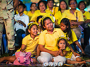 05 DECEMBER 2014 - BANGKOK, THAILAND: A family on Sanam Luang for the celebration of the King's Birthday. Thais marked the 87th birthday of Bhumibol Adulyadej, the King of Thailand, Friday. The King was born on December 5, 1927, in Cambridge, Massachusetts. The family was in the United States because his father, Prince Mahidol, was studying Public Health at Harvard University. He has reigned since 1946 and is the world's currently reigning longest serving monarch and the longest serving monarch in Thai history. Bhumibol, who is in poor health, is revered by the Thai people. His birthday is a national holiday and is also celebrated as Father's Day. He is currently hospitalized in Siriraj Hospital, recovering from a series of health setbacks.     PHOTO BY JACK KURTZ