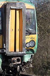 © Licensed to London News Pictures. 17/02/2018. Horsham, UK. Damage is seen to a train after it hit a car at a level crossing where two people have been killed near the village of Barns Green. Photo credit: Peter Macdiarmid/LNP
