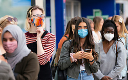 Edinburgh, Scotland, UK. 24 July, 2020. Social distancing in queue by customers wearing facemasks outside Zara on Princes Street in Edinburgh. Iain Masterton/Alamy Live News