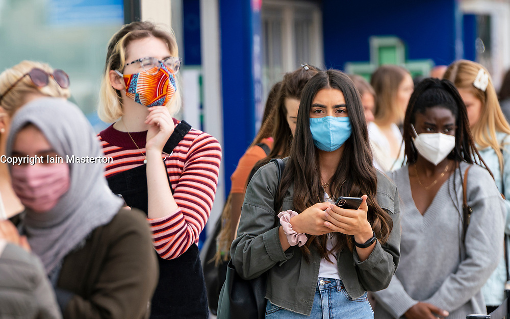 Edinburgh, Scotland, UK. 24 July, 2020. Social distancing in queue by customers wearing facemasks outside Zara on Princes Street in Edinburgh. Iain Masterton/Alamy Live News