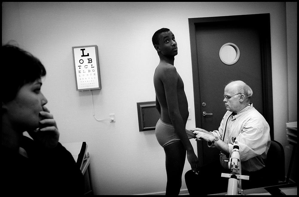 Examination of a black man liable for military service in Copenhagen, Denmark