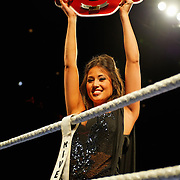 """June 19, 2009 - Richmond, BC - Rumble at the Rock IV - A ring girl displays the Light Heavyweight Title belt prior to the start of the fight..Heavyweight fighters Junior Moar of Richmond, BC, and Abdallah Ramadan of Toronto, Ontario, squared off in a ten round bout for the Canadian Light Heavyweight Title. Ramadan's record going into the fight was 15-8-0 with nine wins by KO. Junior """"The Real Deal"""" Moar's record was 6-2-0 with two wins by KO. .Moar won the Canadian light heavyweight title Friday night when Ramadan was disqualified in the sixth round after seemingly never ending series of low blows..The River Rock Casino Resort hosted the West Coast Promotions Rumble at the Rock VI boxing event at the River Rock Show Theatre."""