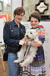 Left to right, JASMINE GUINNESS and LULU GUINNESS with her dog Daphne at a party hosted by Lulu Guinness and Daphne's to launch Lulu's Designer Dog Bowl and to mark Daphne's allowing dogs through it's doors, held at Daphne's, Draycott Avenue, London on 28th June 2016.