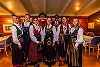 A group of Norwegian women and men attending a wedding reception all wear the bunad (Norwegian national costume), Trysil, Norway.