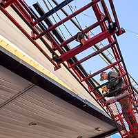 031015       Cable Hoover<br /> <br /> Brad Rudisill with Hinkley Signs reattaches the front panel of the El Morro Theatre marquee in downtown Gallup Tuesday. According the theater manager Frank Bosler the marquee was cleaned and the inner bulbs replaced to give the iconic sign a fresh look for the theater renovations.