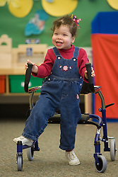 United States, Washington, Bellevue, girl with special needs using walker