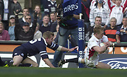Twickenham, Surrey, 22nd March 2003,  RFU Twickenham Stadium, England, [Mandatory Credit; Peter Spurrier/Intersport Images]<br /> <br /> RBS Six Nations Rugby England v Scotland<br /> Scotland full back Glenn Metcalfe graps a t his opposite No, Josh Lewsey as he drops down for a first half try.