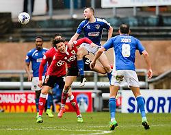 Oldham Athletic's Carl Winchester wins a header against Bristol City's Luke Freeman  - Photo mandatory by-line: Matt McNulty/JMP - Mobile: 07966 386802 - 03/04/2015 - SPORT - Football - Oldham - Boundary Park - Oldham Athletic v Bristol City - Sky Bet League One