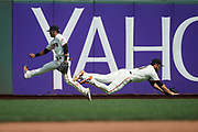 San Francisco Giants center fielder Gorkys Hernandez (66), left, and San Francisco Giants left fielder Mac Williamson (51) scramble for a St. Louis Cardinals fly ball in the outfield at AT&T Park in San Francisco, California, on September 3, 2017. (Stan Olszewski/Special to S.F. Examiner)