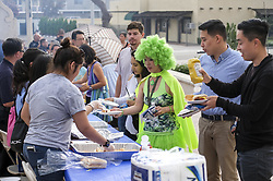 July 31, 2017 - Los Angeles, California, U.S - Participants line for free food during National Night Out in San Gabriel, California, on Tuesday, Aug. 1, 2017. National Night Out is a community-police awareness-raising event in the United States and Canada, held the first Tuesday of August. Texas and Florida have the option to use the alternate date of the first Tuesday in October to avoid hot weather. (Credit Image: © Ringo Chiu via ZUMA Wire)