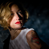 Portrait of a woman in a dark setting