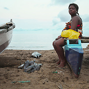 Boats returning from the sea at small fishing village outside São Tomé city.