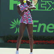 Venus Williams of the United States returns a shot against Caroline Wozniacki of Denmark during their match at the Miami Open tennis tournament at Crandon Park on Monday, March 30, 2015 in Key Biscayne, Florida. Williams won the match. (AP Photo/Alex Menendez)