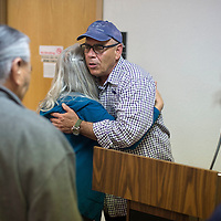 Jimmy Santiago Baca gives Mirakhel Windsong a hug after his public reading to kick off the 2016 Gallup Author's Festival held at Octavia Fellin Library in Gallup Friday.