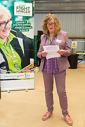Beaver Community Trust Business Manager Sheila Tong speaks to the gathering at the opening of FareShare's relocated warehouse in Ashford, Kent. Ashford, Kent, May 23 2019.