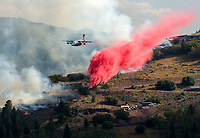 A heavy taker drops a load of slurry on the the Saddle Butte Fire on East Gros Ventre Butte in Jackson, Wyo.