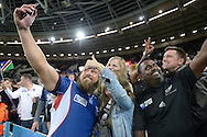PJ Van Lill of Namibia takes  a selfie with with New Zealand fans after the match. Rugby World Cup 2015 pool C match, New Zealand v Namibia at Olympic Stadium in London on Thursday 24th September 2015.<br /> pic by John Patrick Fletcher, Andrew Orchard sports photography.