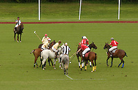 Town of Wallkill, NY - An umpire, in striped shirt, bowls the ball at the start of a polo match at the Blue Sky Polo Club on Aug. 19, 2007.
