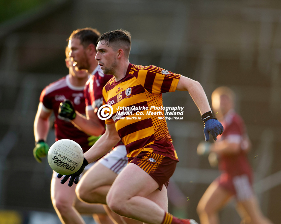 27-07-21. Carnaross v St. Vincent's Tailteann Cup Final 2020.<br /> Paddy McDermott, Carnaross solos forward with Robert Tallon St. Vincents alongside in the Meath Tailteann Cup Final 2020.<br /> Photo: John Quirke / www.quirke.ie<br /> ©John Quirke Photography, 16 Proudstown Road, Navan. Co. Meath. (info@quirke.ie / 046-9028461 / 087-2579454).