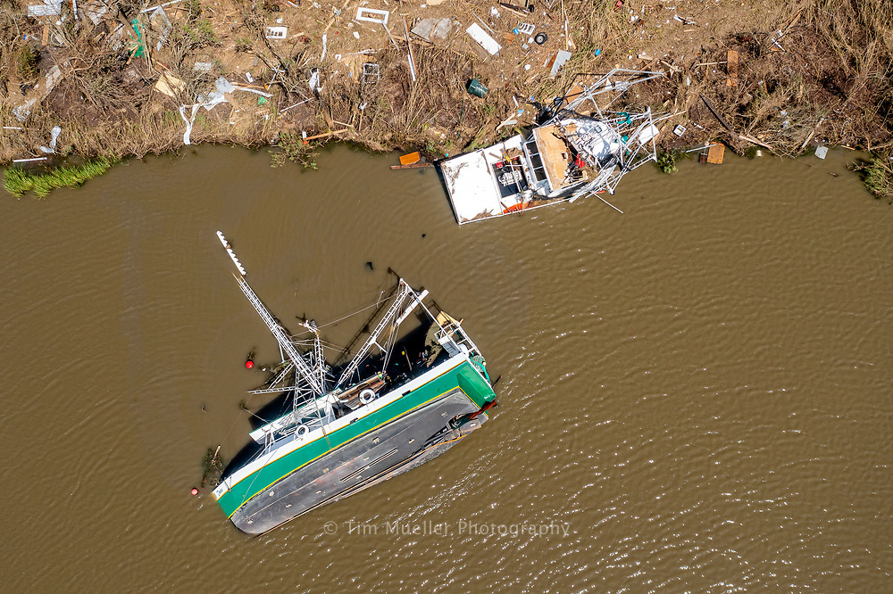 Shrimp boats flipped and grounded  lay damaged in Bayou Petit Caillou south of Chauvin, La. after Hurricane Ida passed through with winds of up to 150 mph.
