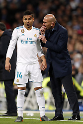 (l-r) Casemiro of Real Madrid, coach Zinedine Zidane of Real Madrid during the UEFA Champions League quarter final match between Real Madrid and Juventus FC at the Santiago Bernabeu stadium on April 11, 2018 in Madrid, Spain