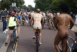 © Licensed to London News Pictures. 14/08/2021. London, UK. Naked cyclists take part in the World Naked Bike Ride in central London. Activists are protesting against the global dependency on oil and are calling for an end to the car culture. Photo credit: Peter Macdiarmid/LNP