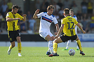MJ Williams is challenged during the EFL Sky Bet League 1 match between Burton Albion and Rochdale at the Pirelli Stadium, Burton upon Trent, England on 4 August 2018.