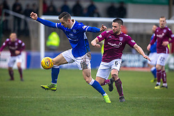 Queen of the South's Deirmantas Petravicious and Arbroath's Mark Whatley. Arbroath 2 v 0 Queen of the South, Scottish Championship game played 15/2/2020 at Arbroath's home ground, Gayfield Park.