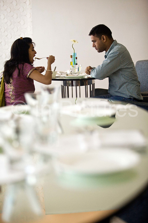 A couple eat lunch in the Mist restaurant in the Park Hotel New Delhi, India