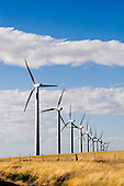 Photographs of a modern windfarm in central Oregon, with wide open skies, and golden farmers fields.