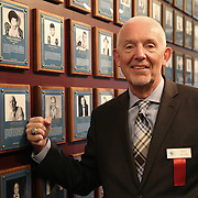 CANASTOTA, NY - JUNE 14: Boxing columnist Nigel Collins poses with his new ring and photo on the wall after the induction ceremony at the International Boxing Hall of Fame induction Weekend of Champions events on June 14, 2015 in Canastota, New York. (Photo by Alex Menendez/Getty Images) *** Local Caption *** Nigel Collins