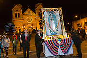 Catholic faithful carry the likeness of the Virgin Mary during a procession from the Cathedral Basilica of St. Francis of Assisi celebrating our Lady of Guadalupe December 11, 2015 in Santa Fe, New Mexico. Guadalupanos as the devotees are known, celebrate the apparitions of the Virgin Mary to an Aztec peasant at Tepeyac, Mexico in 1531.