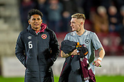 Substitutes Demetri Mitchell (#11)(left) and Callumn Morrison (#38) of Heart of Midlothian make ther way to the technical area before the Ladbrokes Scottish Premiership match between Heart of Midlothian and Livingston at Tynecastle Stadium, Edinburgh, Scotland on 6 February 2019.