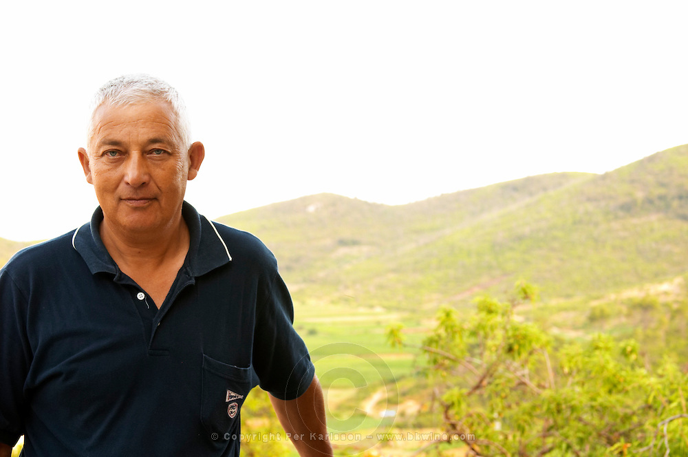 Frano Banicevic, the previous generation winemaker, father of Paval who now runs the winery. View over the vineyards in the background Toreta Vinarija Winery in Smokvica village on Korcula island. Vinarija Toreta Winery, Smokvica town. Peljesac peninsula. Dalmatian Coast, Croatia, Europe.