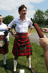 Prime Minister Justin Trudeau wearing kilt, talks to reporters while attending the 70th annual Glengarry Highland Games in Maxville, ON, Canada, Friday, August 4, 2017. Photo by Fred Chartrand/CP/ABACAPRESS.COM  | 602249_002 Maxville Canada