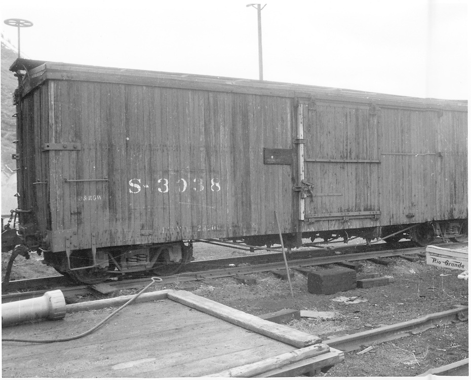 Side view of box car #3038.<br /> D&RGW    <br /> This is an enlargement from RD054-022.