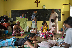 Residents of the Teevanandam family wake up inside a classroom at St. Cecilia's Convent, Batticaloa, Sri Lanka, Jan. 29, 2005. Residents of the small Christian village Dutch Bar spent more than six weeks in a makeshift refugee camp at the local convent recovering from the devastating tsunami that hit the eastern and southern borders of Sri Lanka. They were then moved into another temporary living camp, while awaiting the building of new homes. More than 150 members in this community of less than 1000 people died in the tragic event.